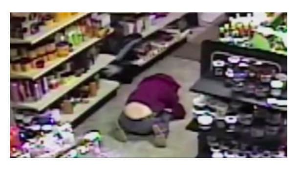 Stranger Saves Child During Armed Robbery (Video) Promo Image