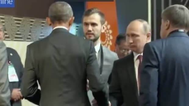 Obama And Putin Exchange Awkward Handshake At Summit Promo Image