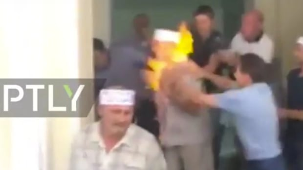 Miner Sets Himself On Fire In Protest Over Pay (Video) Promo Image
