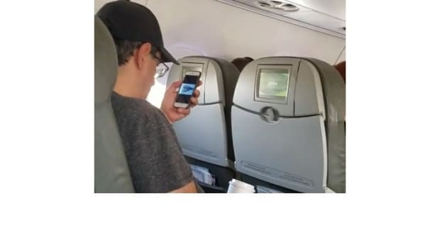 Man Watches 9/11 Attacks Before Takeoff (Video) Promo Image