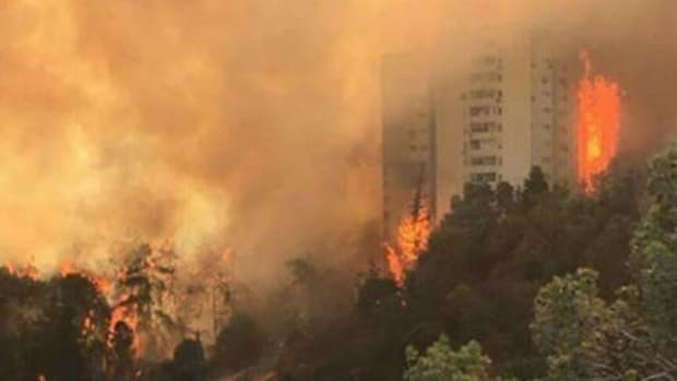 Thousands Flee Fires In Haifa, Israel Promo Image