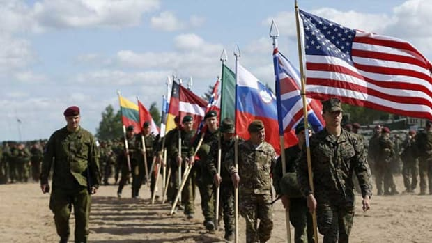 NATO Calls For Large Troop Buildup Along Russian Border Promo Image