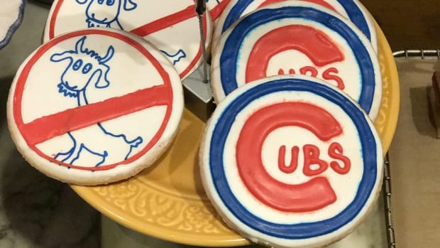 Cubs Execs Celebrated By Eating Goat At Wrigley Field Promo Image