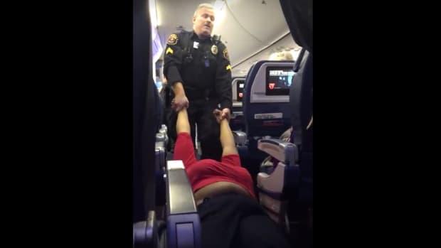 Police Drag Woman Off Delta Flight In Detroit (Video) Promo Image