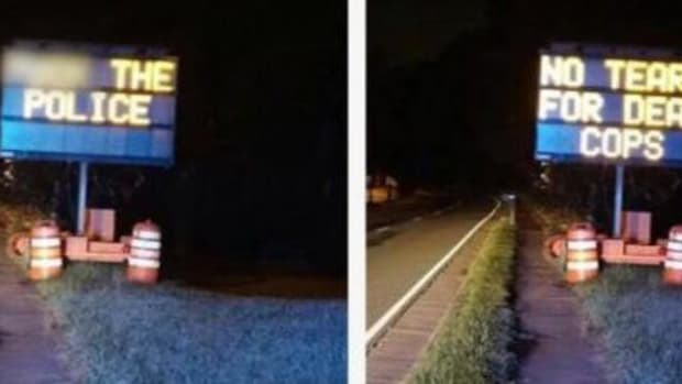 Road Signs Hacked To Display Anti-Police Messages (Photos) Promo Image