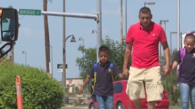 Mexican Father Brings Children Across Border Every Day Promo Image