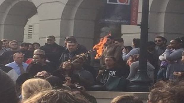 Anti-Trump Protesters Set Fire To American Flag (Photo) Promo Image