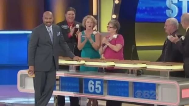 Contestant On 'Family Feud' Shocks Audience By Answering 'Something That Has To Be Licked' (Video) Promo Image