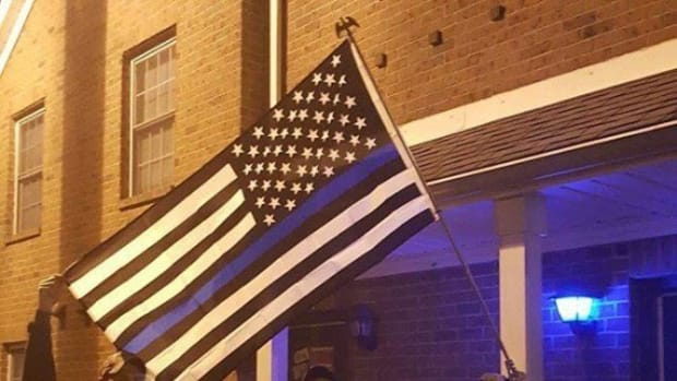 Officers Photograph Student's American Flag, Viewers Stunned When They See What Else Is In Photo Promo Image