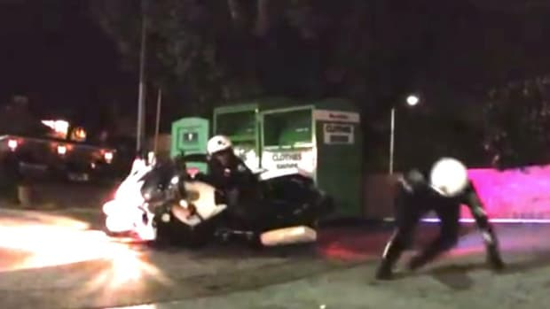 Motorcycle Cops Crash Into Each Other (Video) Promo Image