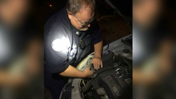 Officer Changes Headlight Instead Of Giving Ticket Promo Image