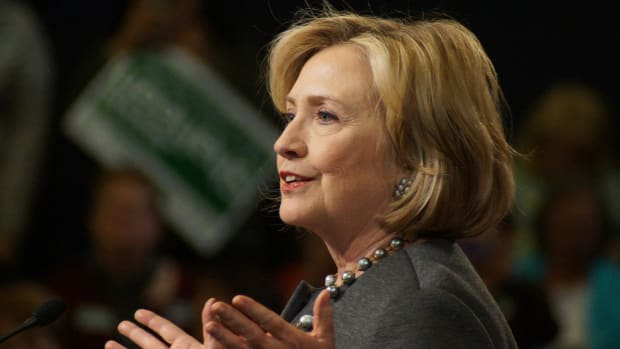 Clinton: Whites Should Walk In Shoes Of African-Americans Promo Image