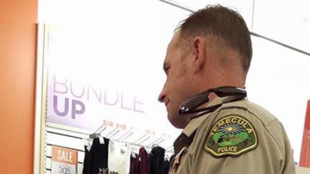 Cop Sees Young Woman Wandering Between Cars In Parking Lot, Decides To Investigate Promo Image