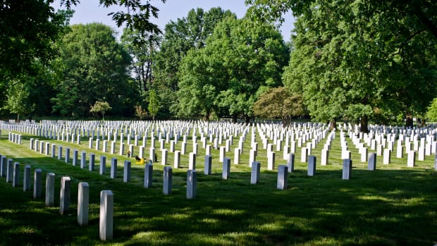 Trump Sings Anthem At National Cemetery, Some Offended (Video) Promo Image