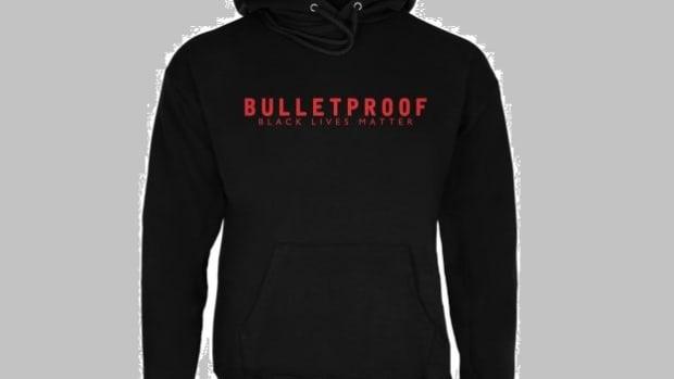 Wal-Mart Pulls 'Bulletproof: Black Lives Matter' Shirts Promo Image