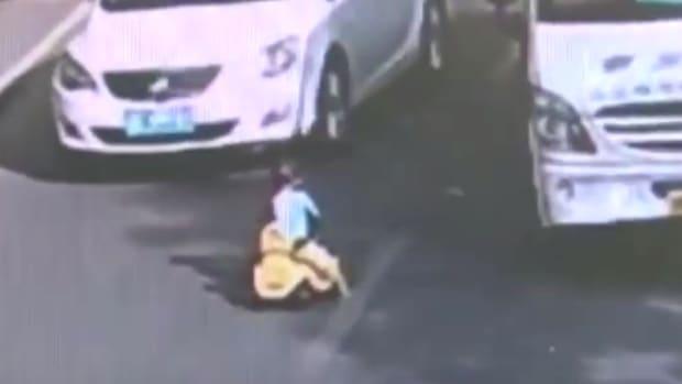 Toddler Rides Toy Bike In Rush Hour Traffic (Video) Promo Image