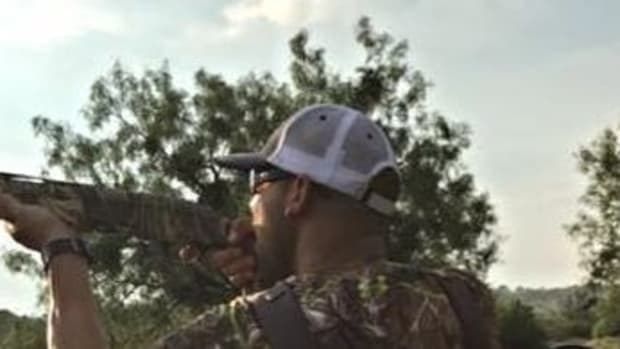 Dad Carries Baby While Hunting With Gun (Photos) Promo Image