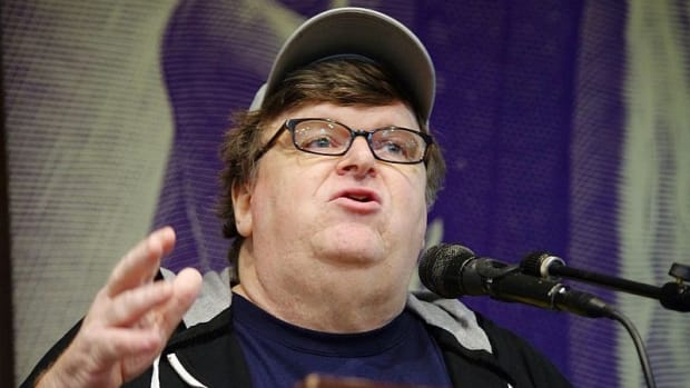 Michael Moore Demands Trump's Resignation Promo Image