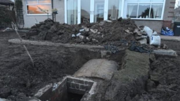 Man Who Couldn't Grow Grass Outside Home For 30 Years Digs Up Yard, Makes Unexpected Find (Photos) Promo Image