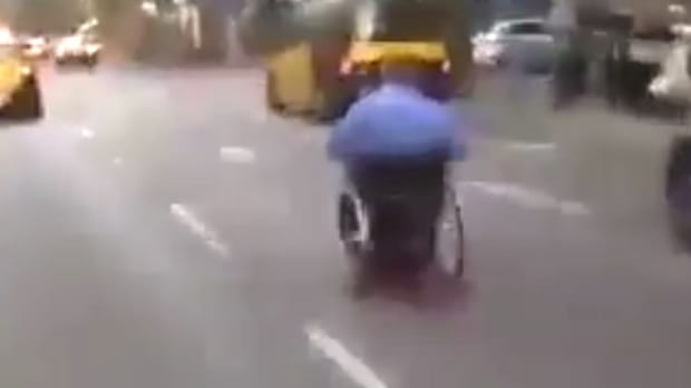 Man Speeds Through City In Electric Wheelchair (Video) Promo Image