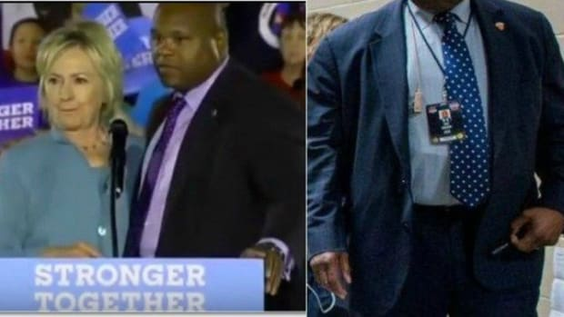 Questions Emerge After Close-Up Shows What Hillary Clinton's 'Handler' Is Holding (Photos) Promo Image