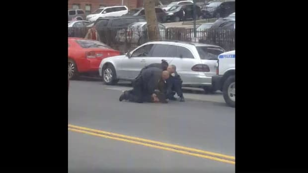 NYPD Officer Punches Handcuffed Man In Face (Video) Promo Image