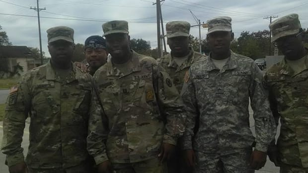 Soldiers Help Woman Stranded On Highway (Photo) Promo Image