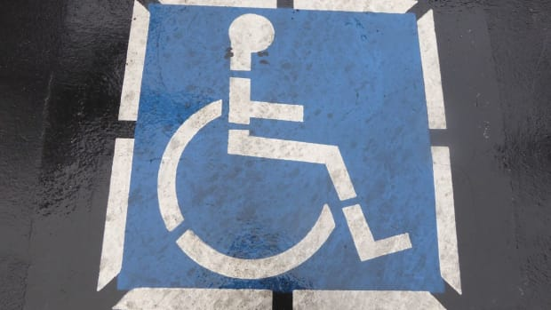Woman Learns Why It's Wrong To Park In A Handicap Spot (Video) Promo Image