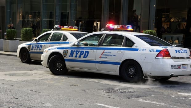 New York Officer Points At Gun At Man Filming Police (Video) Promo Image