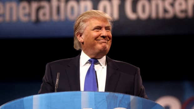 Trump Plays Golf As Russia Threatens Retaliation (Photos) Promo Image