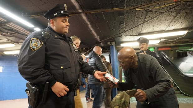 Cop Gives Diabetic Homeless Man A Chrismas Gift Promo Image