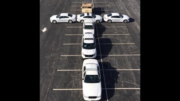 Missouri Police Park Cars In Christian Cross Shape Promo Image