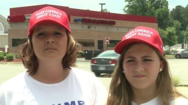 Mom, Daughter Denied Service Because Of What Their Hats Said (Photos) Promo Image