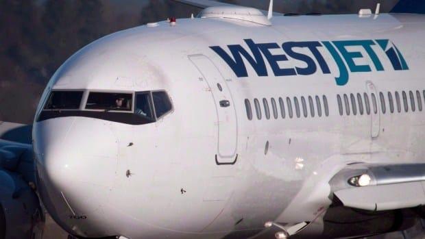 Passengers Help Subdue Unruly Man On Westjet Flight Promo Image