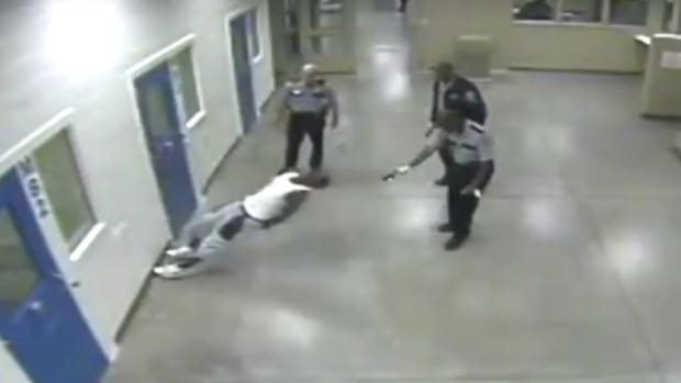 Cops Use Stun Guns On Compliant Black Man In Jail (Video) Promo Image