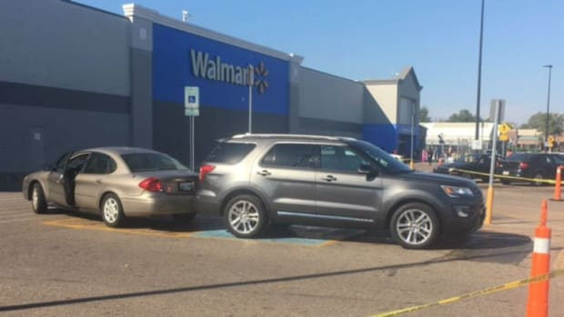 Woman Dies After Being Hit By Own Car At Walmart Promo Image