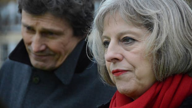 UK Prime Minister Pressured To Cancel Trump Meeting Promo Image