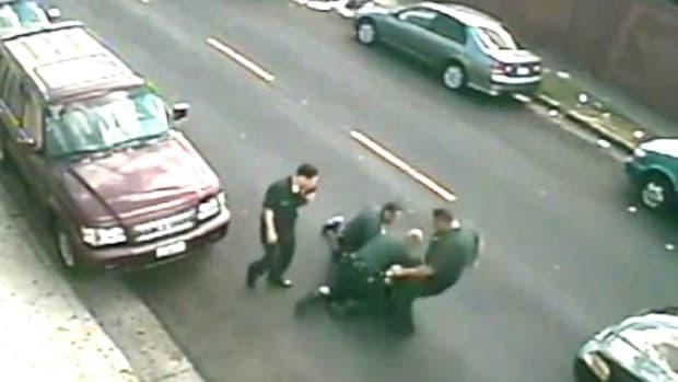 LAPD Cop Beats Black Man Who Surrenders (Video) Promo Image