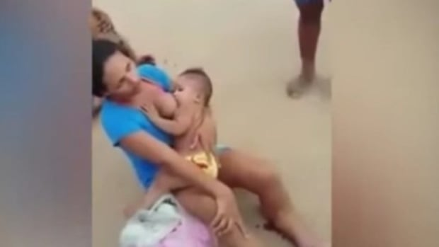 Passersby Notice Woman Breastfeeding On The Ground, Then They See The Blood (Photos) Promo Image