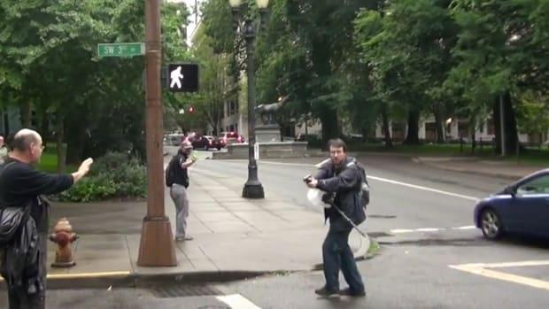 Portland Cops Arrest Man Aiming Gun At Protest (Video) Promo Image