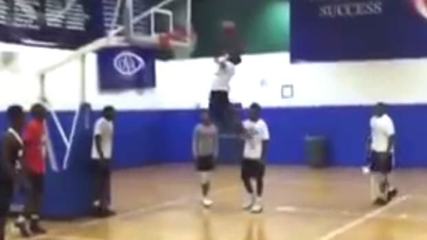 Shortest Person To Ever Dunk A Basketball? (Video) Promo Image