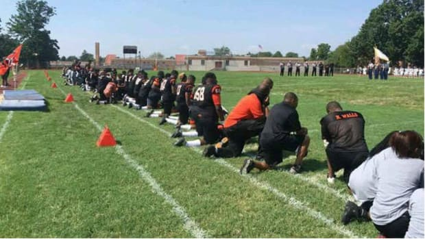 High School Students Kneel During National Anthem (Photos) Promo Image