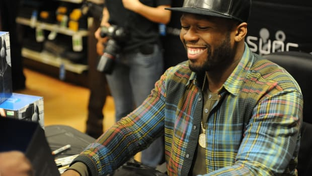 50 Cent Punches Fan In Front Row (Video) Promo Image