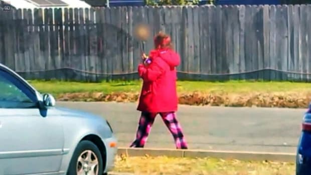 Homeless Woman Seen Carrying Human Skull On A Stick (Photos) Promo Image