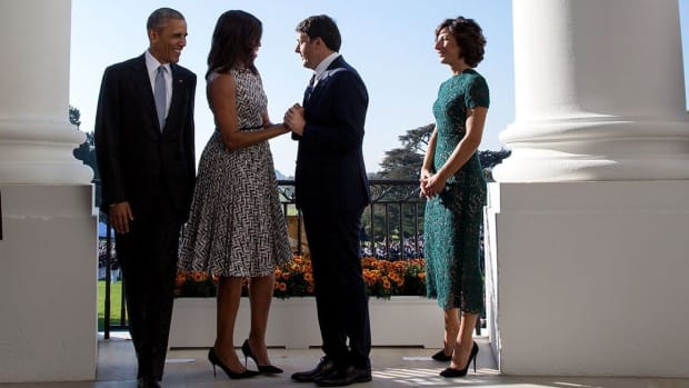 Italian PM Criticized For Gesture Toward First Lady (Photos) Promo Image