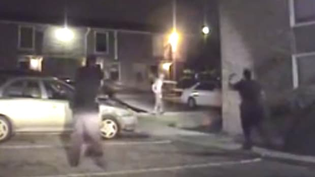 Cop Shoots Shirtless Black Man In Back (Video) Promo Image