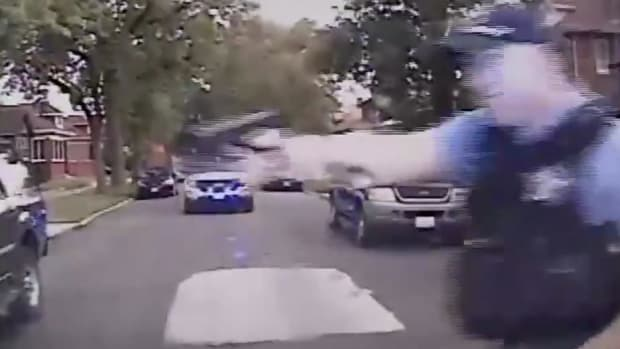 Chaos As Chicago Cops Shoot Car Thief Suspect (Video) Promo Image