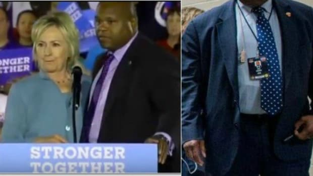 Clinton Handler Seen Holding Mysterious Object (Photos) Promo Image