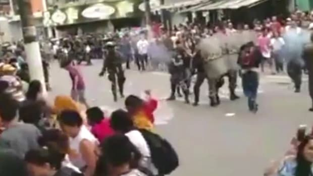 Police Use Tear Gas For Olympic Torch Relay (Video) Promo Image