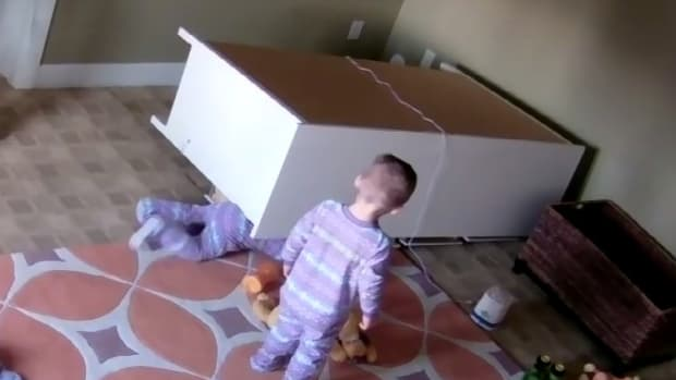 Toddler Saves Twin Brother Trapped Under Dresser (Video) Promo Image
